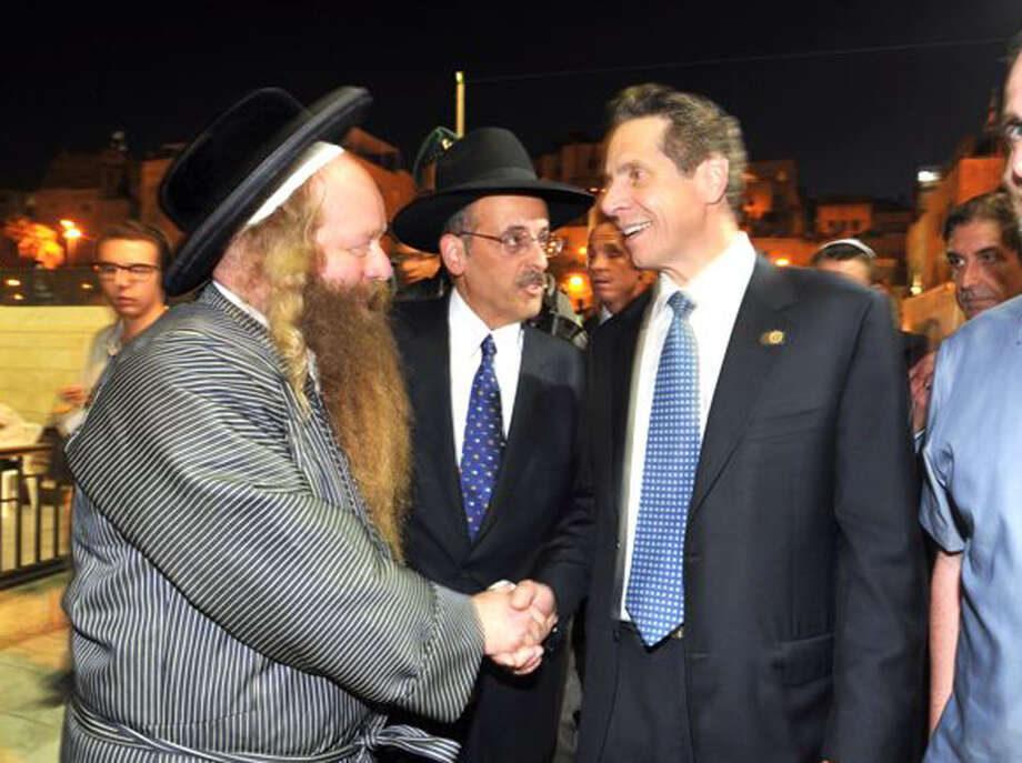 Abraham Eisner, center, introduced Gov. Cuomo, right, to an unidentified man during a visit to the Church of the Holy Sepulchre and the Western Wall in Jerusalem on Aug. 13, 2014. (Office of the Governor)