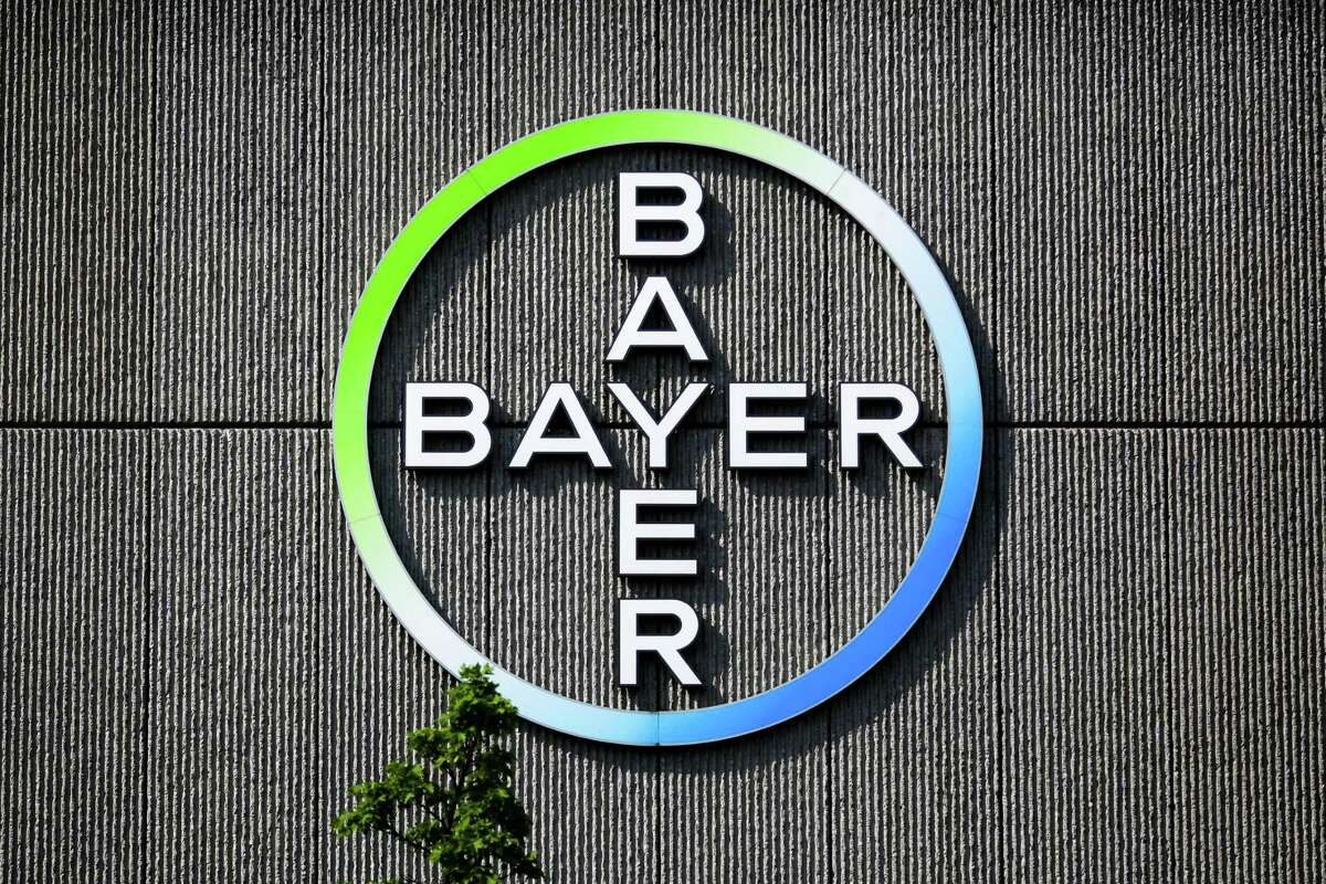 FILE - In this May 23, 2016, file picture the Bayer AG corporate logo is displayed on a building of the German drug and chemicals company in Berlin, Germany. German drug and farm chemical company Bayer AG said it has signed a deal Wednesday, Sept. 14, 2016, to acquire seed and weed-killer company Monsanto for about $66 billion in cash. (AP Photo/Markus Schreiber) ORG XMIT: NY109