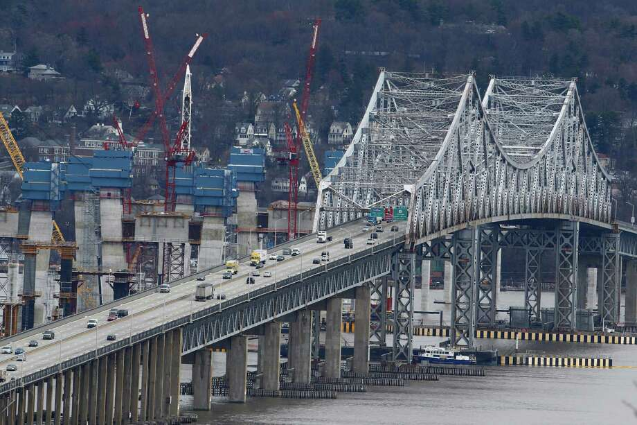 In this March 15, 2016, photo, construction continues on the Tappan Zee Bridge as seen from Nyack, N.Y. New York lawmakers are considering a budget proposal from Gov. Andrew Cuomo to devote $1 billion in financial settlement money to help the authority pay for a budget-busting replacement for the Tappan Zee Bridge while keeping tolls down. (AP Photo/Julio Cortez) ORG XMIT: NYR301 Photo: Julio Cortez / Copyright 2016 The Associated Press. All rights reserved. This m