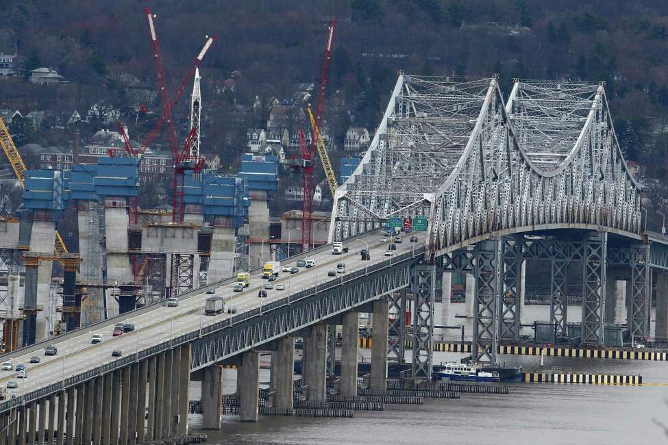 In this March 15, 2016, photo, construction continues on the Tappan Zee Bridge as seen from Nyack, N.Y. New York lawmakers are considering a budget proposal from Gov. Andrew Cuomo to devote $1 billion in financial settlement money to help the authority pay for a budget-busting replacement for the Tappan Zee Bridge while keeping tolls down. (AP Photo/Julio Cortez) ORG XMIT: NYR301
