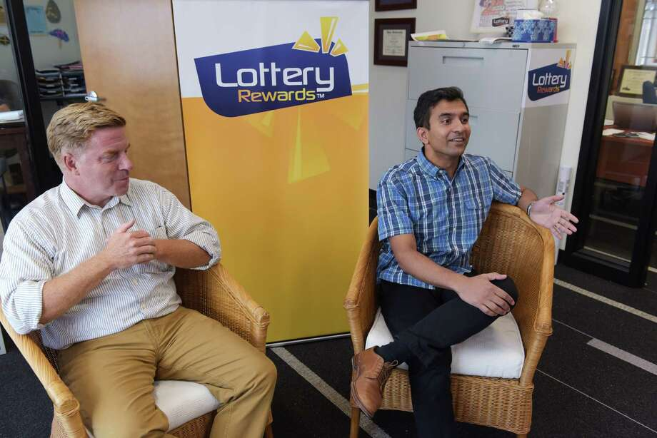 Jeff Perlee, left, founder and CEO of Lottery Rewards, and investor Guha Bala with Velan Ventures, talk about Lottery Rewards and its business during an interview on Wednesday, Sept. 14, 2016, in Schenectady, N.Y.   (Paul Buckowski / Times Union) Photo: PAUL BUCKOWSKI / 40038018A