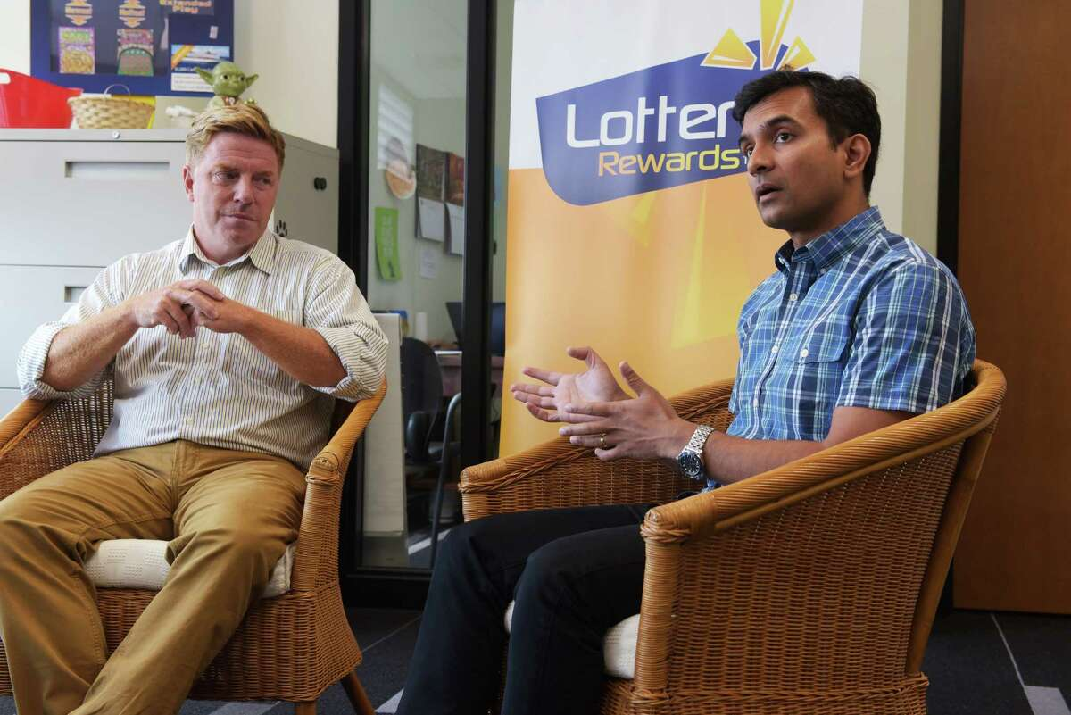 Jeff Perlee, left, founder and CEO of Lottery Rewards, and investor Guha Bala with Velan Ventures, talk about Lottery Rewards and its business during an interview on Wednesday, Sept. 14, 2016, in Schenectady, N.Y. (Paul Buckowski / Times Union)