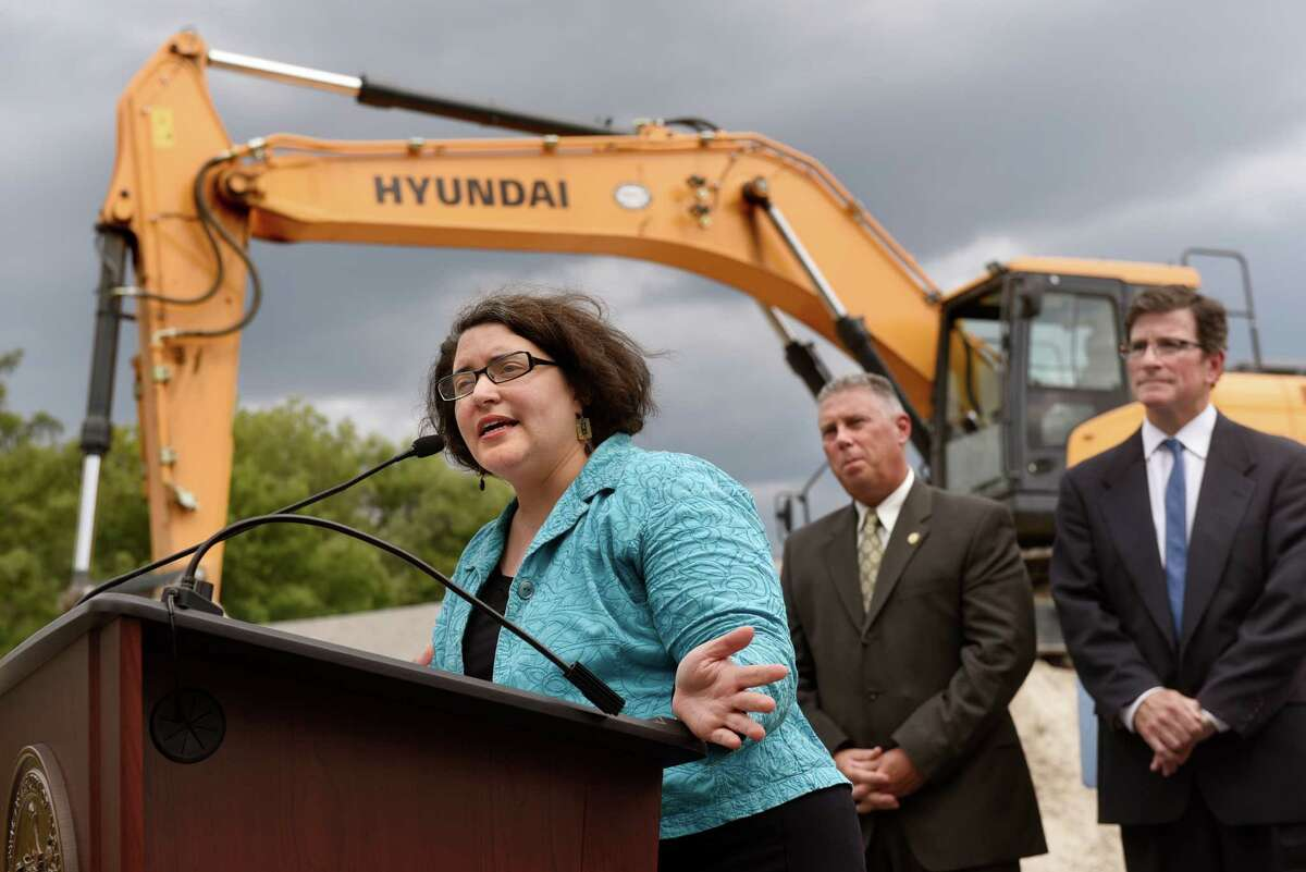Ward 10 Councilwoman Leah Golby, left, discusses a water infrastructure project on Wednesday, Sept. 14, 2016, at Woodlawn Park in Albany, N.Y. Joining her are Assemblyman John T. McDonald III, center, and DEC Deputy Commissioner Jim Tierney, of Water Resources. (Cindy Schultz / Times Union)