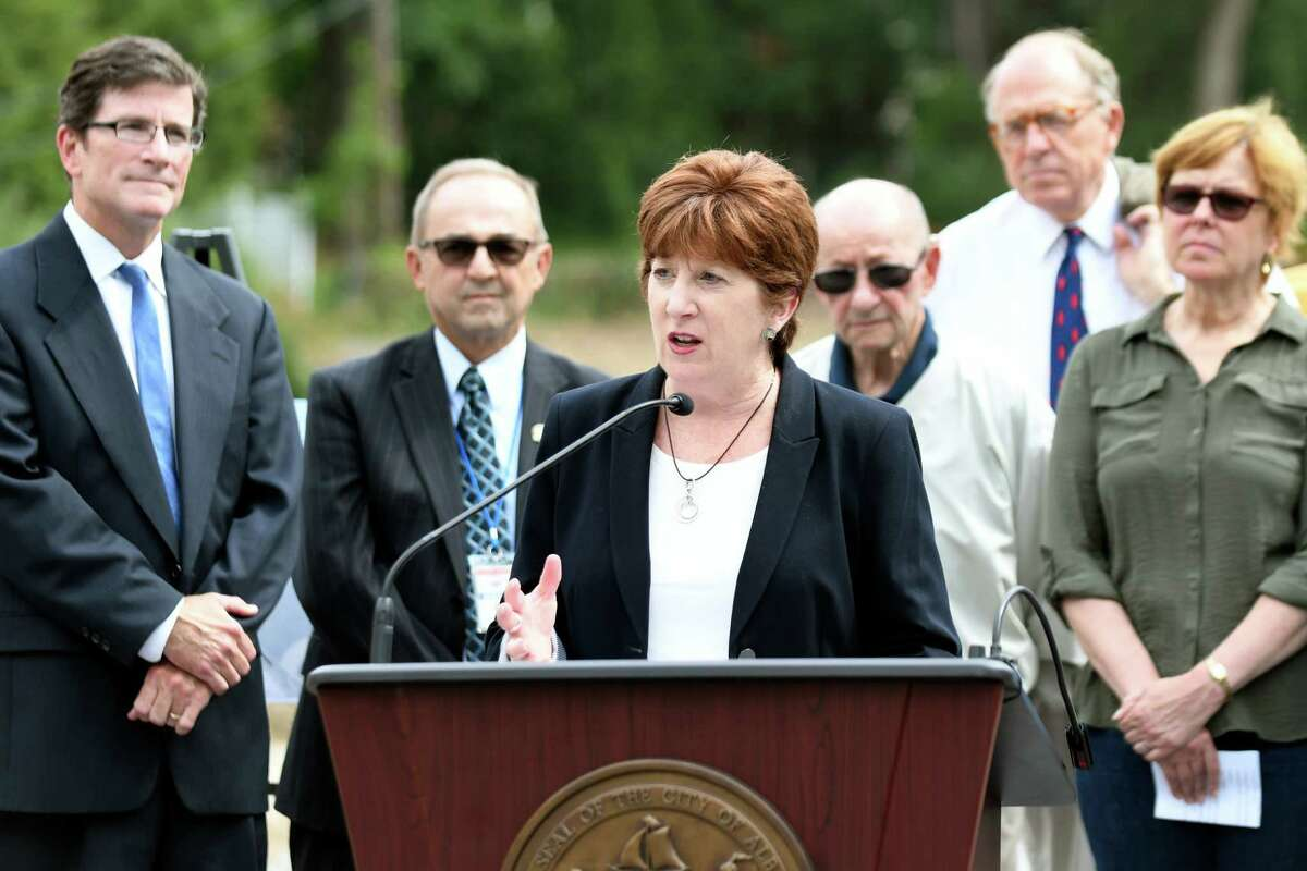 Mayor Kathy Sheehan, center, joins officials in announcing a water infrastructure project on Wednesday, Sept. 14, 2016, at Woodlawn Park in Albany, N.Y. Joining her, from left, are DEC Deputy Commissioner Jim Tierney, Water Commissioner Joe Coffey, Gardner Lerner of the Water Finance Authority, Chuck Houghton of the Water Board and Ward 10 Councilwoman Judy Doesschate. (Cindy Schultz / Times Union)