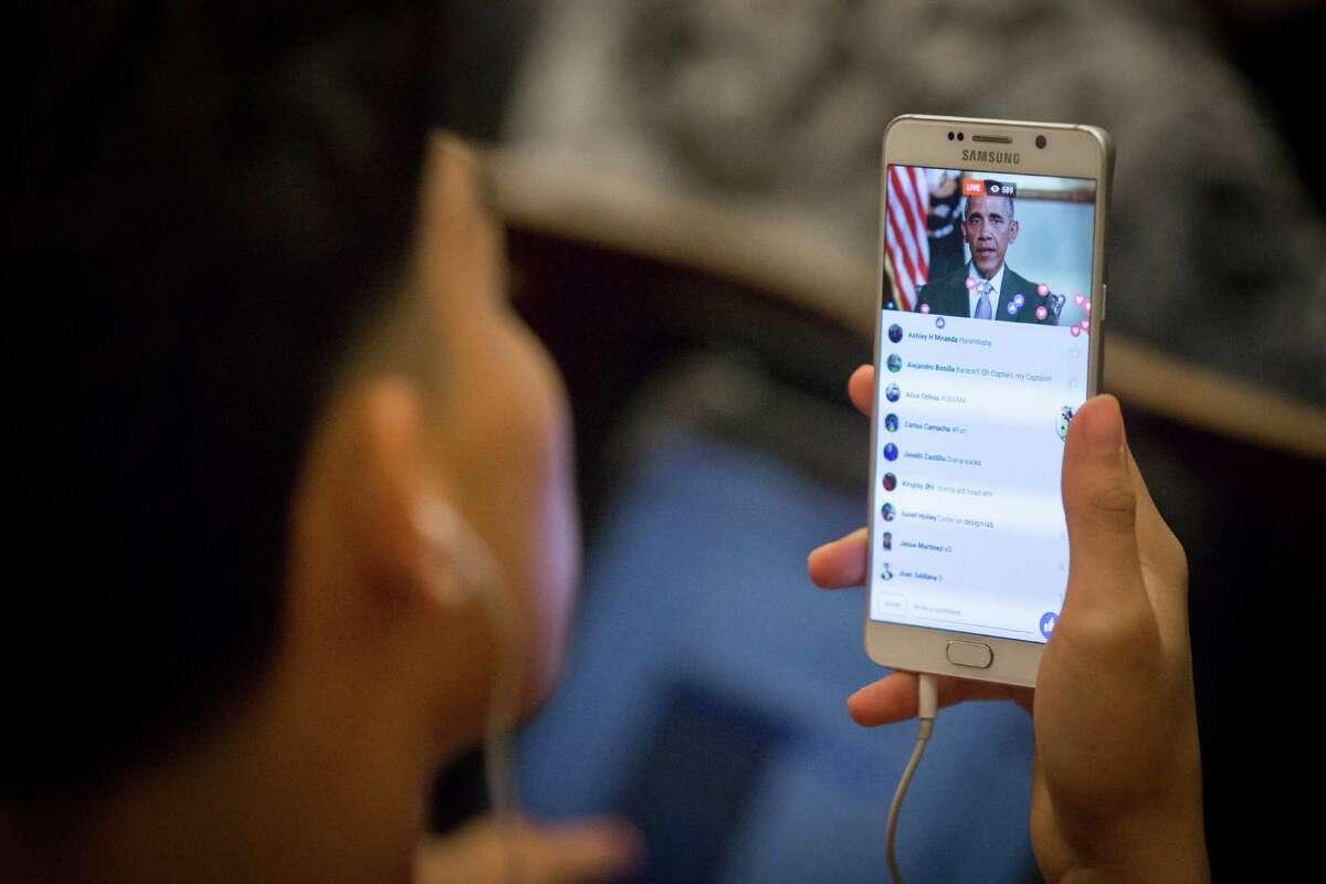 A Furr High School student watches President Barack Obama speak to the schools that won grants sponsored by Steve Jobs' widow.