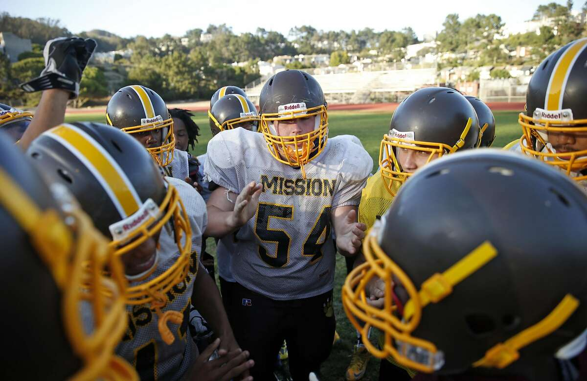 Mission High School football's Brendan Shepherd (54) and teammates huddle during practice in San Francisco, Calif., on Wednesday, September 14, 2016.