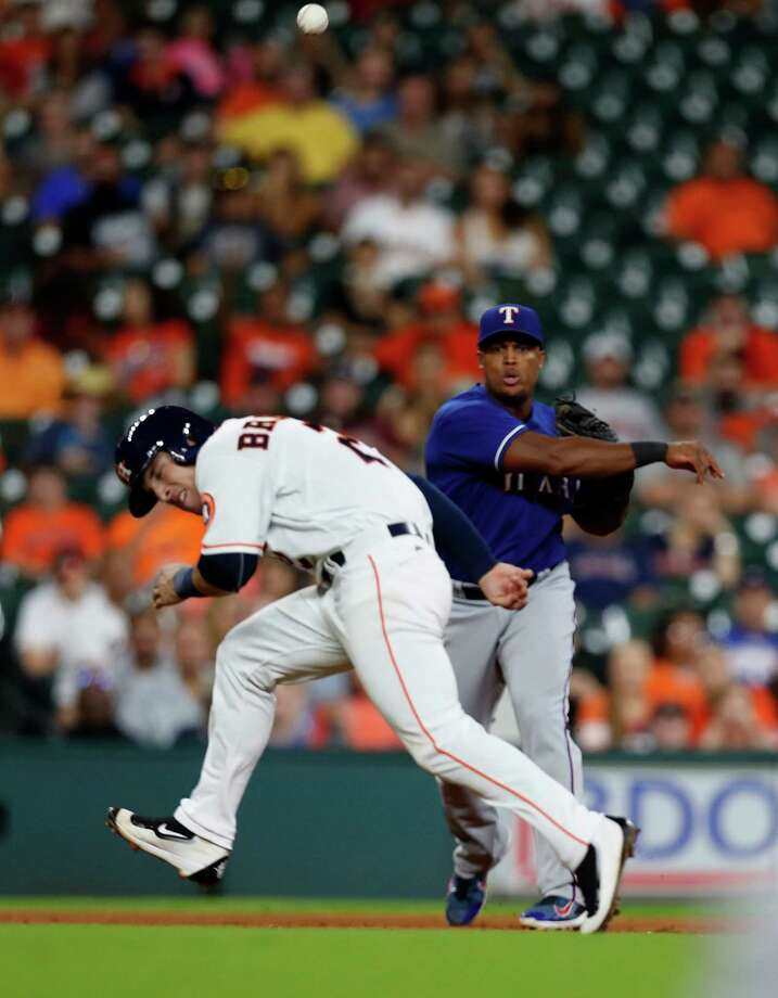 Houston Astros Alex Bregman (2) ducks to avoid getting hit by Texas Rangers third baseman Adrian Beltre's throw to first as Tyler White grounded out during the sixth inning of an MLB game at Minute Maid Park, Wednesday, Sept. 14, 2016 in Houston. Bergman was injured on the play. Photo: Karen Warren, Houston Chronicle / 2016 Houston Chronicle