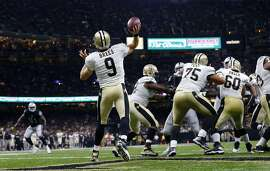 New Orleans Saints quarterback Drew Brees (9) throws a touchdown pass to Brandin Cooks, not pictured, in the second half of an NFL football game against the Oakland Raiders in New Orleans, Sunday, Sept. 11, 2016. It was the longest pass play in franchise history. (AP Photo/Butch Dill)