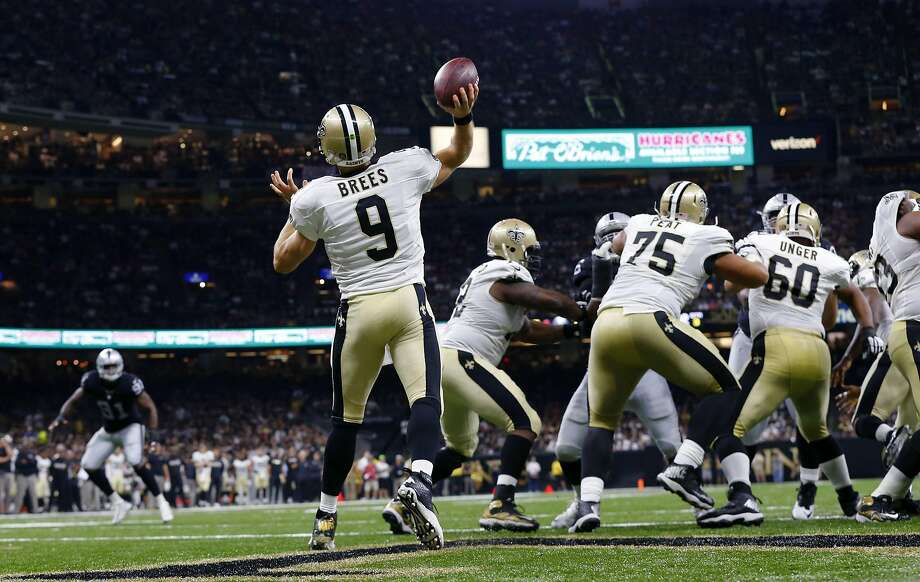 New Orleans Saints quarterback Drew Brees (9) throws a touchdown pass to Brandin Cooks, not pictured, in the second half of an NFL football game against the Oakland Raiders in New Orleans, Sunday, Sept. 11, 2016. It was the longest pass play in franchise history. (AP Photo/Butch Dill) Photo: Butch Dill, Associated Press