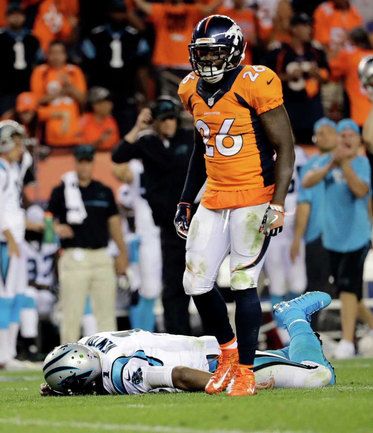 FILE - In this Sept. 8, 2016, file photo, Carolina Panthers quarterback Cam Newton (1) lies on the turf after a roughing the passer penalty was called on Denver Broncos free safety Darian Stewart (26) during the second half of an NFL football game in Denver. s some Broncos players prepare to face the financial consequences of their helmet-to-helmet hits on Cam Newton, they insist they're not a dirty defense, although they don't really mind if that's their reputation. (AP Photo/Joe Mahoney, File) ORG XMIT: NY182