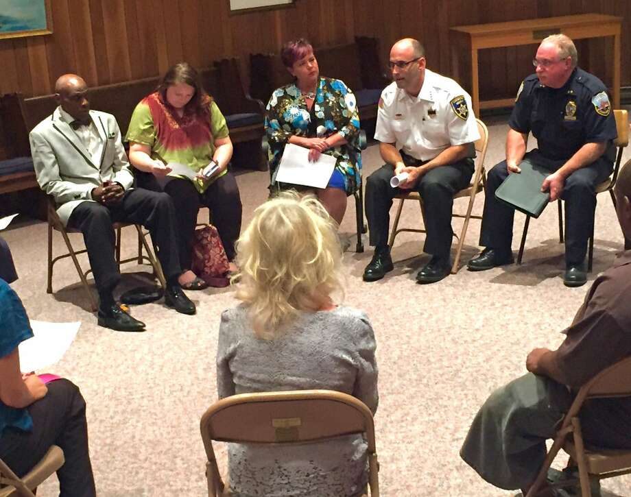 Schenectady police officers and community members discuss bias and other issues in a small group session during a larger forum on police-community relations Wednesday Sept. 14 in Schenectady. (Robert Downen / Times Union)