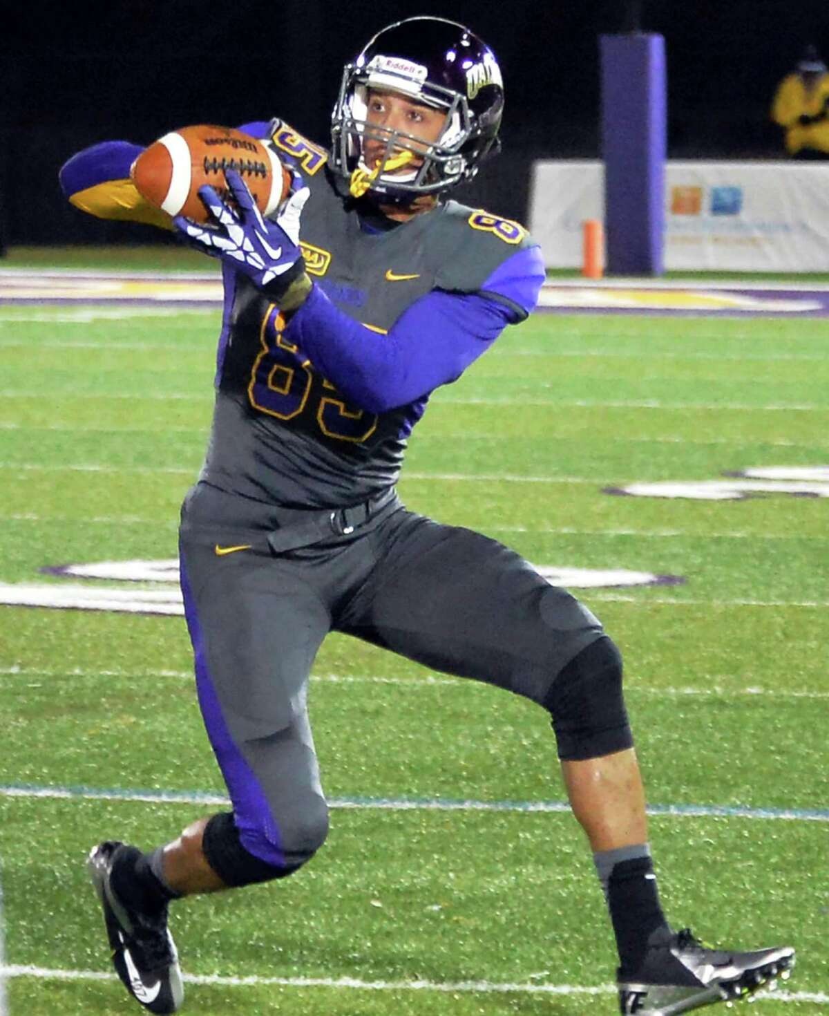 UAlbany wide receiver Brad Harris catches a pass from QB Nevin Sussman during Saturday's game ageinst UNH at Casey Stadium Nov. 14, 2015 in Albany, NY. (John Carl D'Annibale / Times Union)