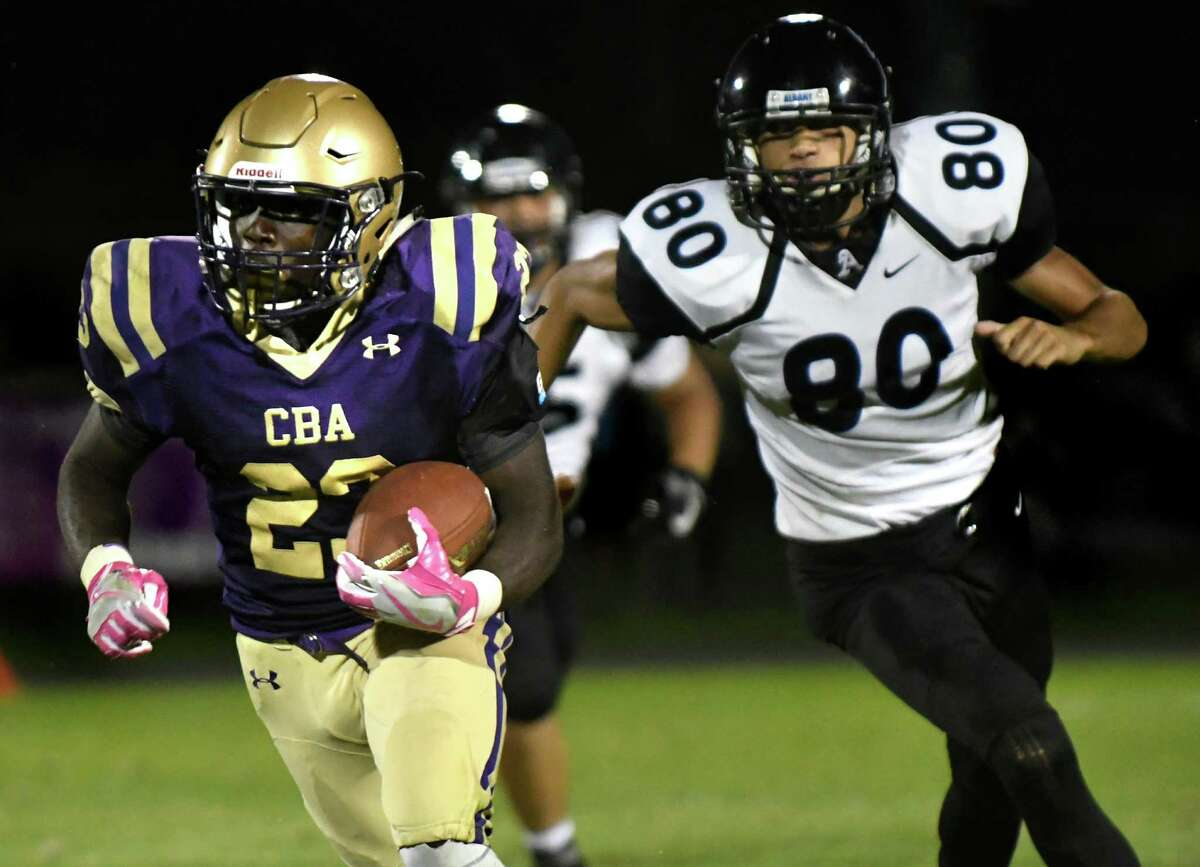 CBA's Taurian Taylor, left, carries the ball as Albany's Phillip Williams defends during their football game on Friday, Sept. 9, 2016, at Christian Brothers Academy in Colonie, N.Y. (Cindy Schultz / Times Union)