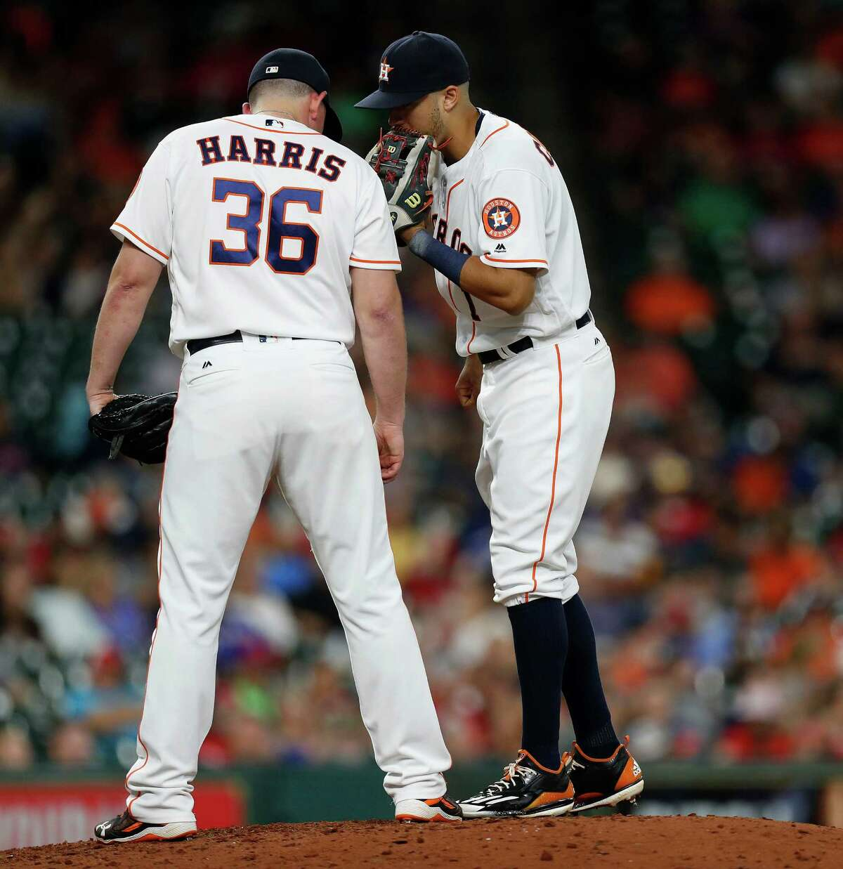 Houston Astros shortstop Carlos Correa (1) talks with relief pitcher Will Harris (36) during the eighth inning of an MLB game at Minute Maid Park, Wednesday, Sept. 14, 2016 in Houston.
