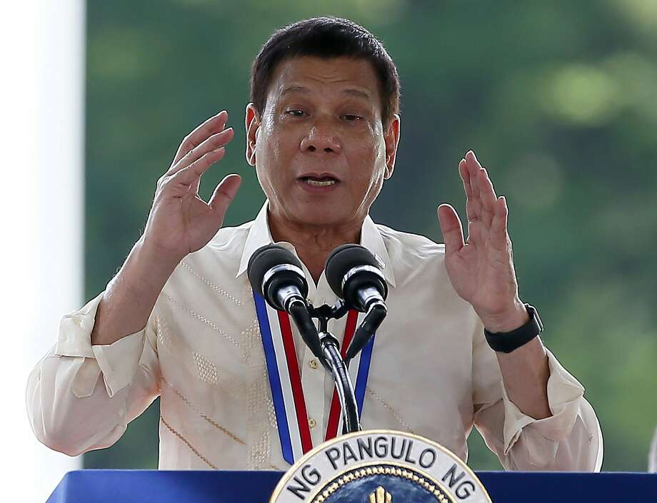 Philippine President Rodrigo Duterte gestures while addressing guests following a wreath-laying ceremony in observance of National Heroes Day at the Heroes Cemetery in suburban Taguig city, east of Manila, Philippines. China opposed raising its maritime disputes with neighbors at international meetings, two of which are taking place on Sunday, Sept. 4, 2016. To Beijings pleasure, Duterte said he will not raise the subject of Chinas compliance with an international tribunals ruling that invalidated Beijings territorial claims in the South China Sea. (AP Photo/Bullit Marquez, File) Photo: Bullit Marquez, Associated Press