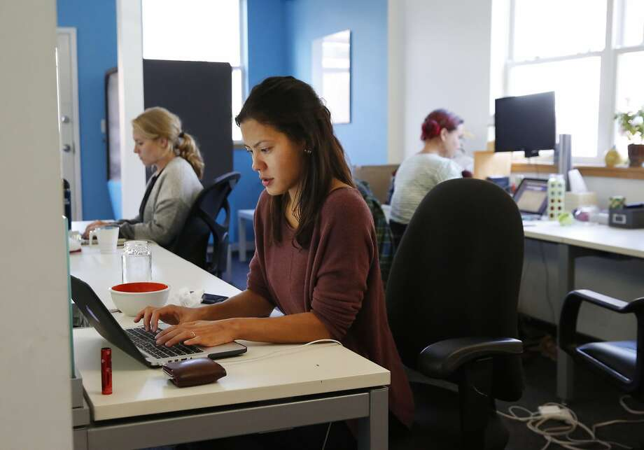 Dani Zacarias, Director of Content, works at her desk at Worldreader's San Francisco office Sept. 13, 2016 in San Francisco, Calif. Photo: Leah Millis, The Chronicle