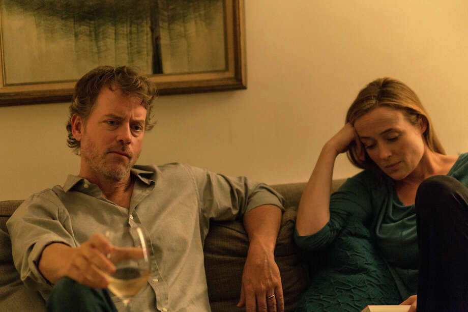 """This image released by Magnolia Pictures shows Greg Kinnear, left, and Jennifer Ehle in a scene from, """"Little Men."""" (Magnolia Pictures via AP) Photo: Associated Press / Magnolia Pictures"""