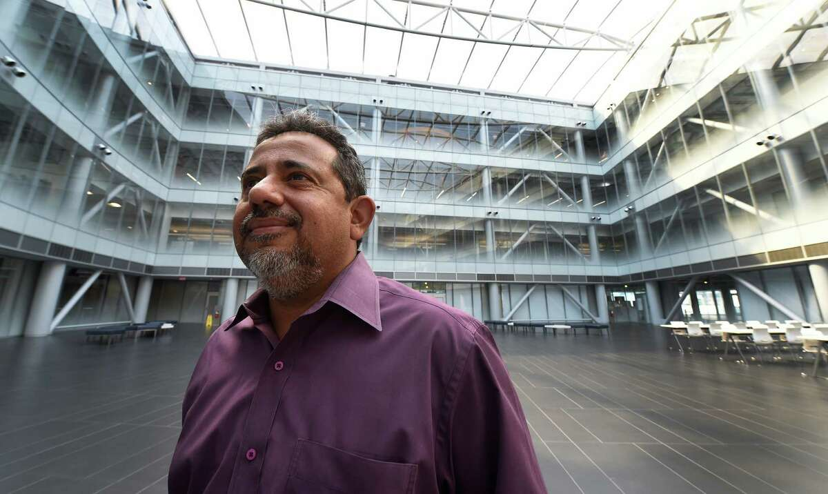 Professor Pradeep Halder stands in the atrium within the Zen building at the College of Nanoscale Science and Engineering and SUNY Polytechnic Friday Sept. 9, 2016 in Albany, N.Y. (Skip Dickstein/Times Union)