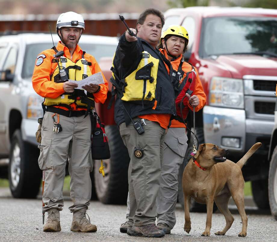 COLORADO CITY, AZ - SEPTEMBER 15: Personnel from the Mohave County Sheriffs Search and Rescue prepare to search Short Creek for missing bodies on September 15, 2015 in Colorado City, Arizona. Flash floods from heavy rains on  the afternoon of September 14, 2015 washed away two cars in Hildale as they were crossing a flooded creek, killing 8 people with five still missing. (Photo by George Frey/Getty Images Photo: George Frey/Getty Images