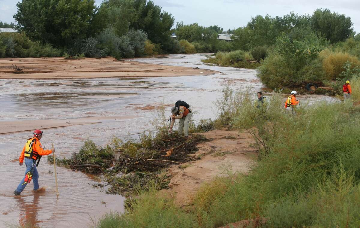 COLORADO CITY, AZ - SEPTEMBER 15: Personnel from the Mohave County Sheriffs Search and Rescue search Short Creek for missing bodies on September 15, 2015 in Colorado City, Arizona. Flash floods from heavy rains on the afternoon of September 14, 2015 washed away two cars in Hildale as they were crossing a flooded creek, killing 8 people with five still missing. (Photo by George Frey/Getty Images