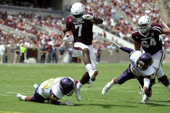 Texas A&M running back Keith Ford (7) steps out of a tackle from Prairie View A&M linebacker Steven Guillory (45) while on his way to the end zone for a touchdown during the second half of an NCAA college football game Saturday, Sept. 10, 2016, in College Station, Texas. (AP Photo/Sam Craft)
