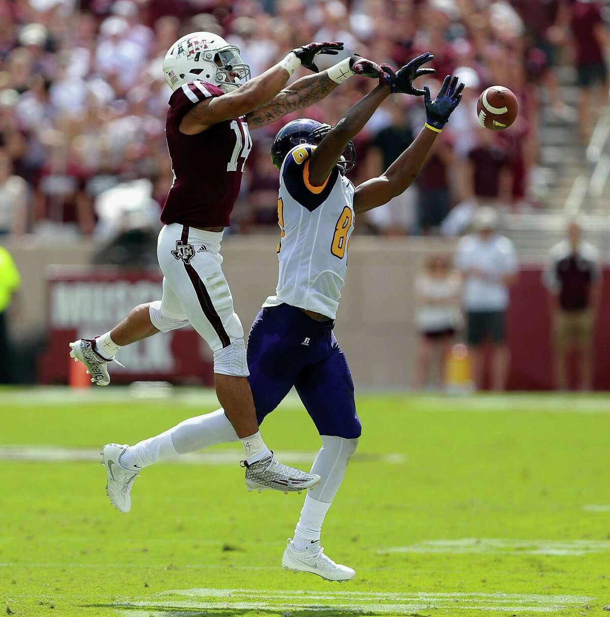 Strong plays like deflecting this pass intended for Prairie View A&M's Demarquo Lastrappe, has earned Texas A&M's Justin Evans, left, some early season notoriety.