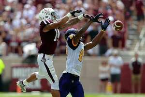 In deflecting a pass intended for Prairie View A&M's Demarquo Lastrappe, right, Texas A&M's Justin Evans helped the Aggies post their first home shutout since 2004.