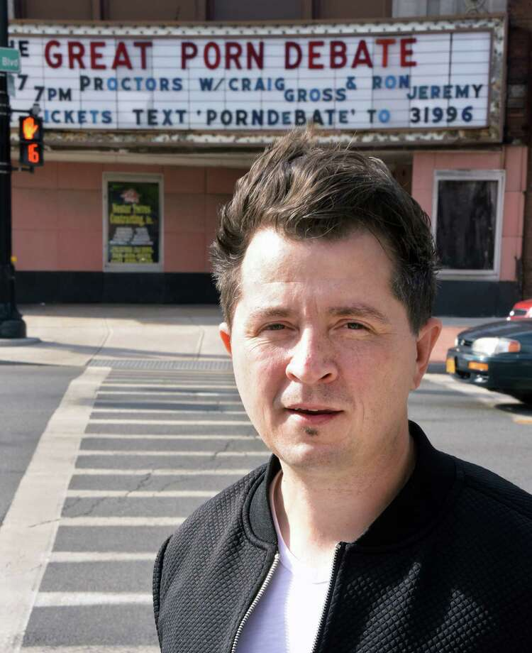 """Pastor Jason Cooper of CityReach Church in Schenectady in front of a marquee announcing """"The Great Porn Debate"""" Wednesday Sept. 14, 2016 in Schenectady, NY. Cooper's church is sponsoring the event to be held at Proctors on Sept. 27.  (John Carl D'Annibale / Times Union) Photo: John Carl D'Annibale / 40038026A"""
