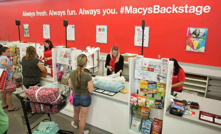 IMAGE DISTRIBUTED FOR MACY'S BACKSTAGE - Shoppers pay for their items during the grand opening celebration for Macy's Backstage at The Rim, Saturday, Sept. 10, 2016, in San Antonio. (Darren Abate/AP Images for Macy's Backstage)