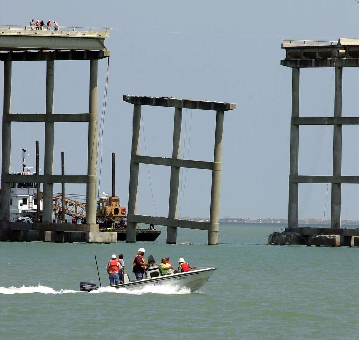 A boat passes a section of the Queen Isabella Causeway that collapsed as crews survey the area in Port Isabell, Texas, Saturday, Sept. 15, 2001. A section on the bridge collapsed when it was struck by a barge early Saturday morning killing at least four people and plunging cars into the water some 85 feet below. An unknown number of people were missing.