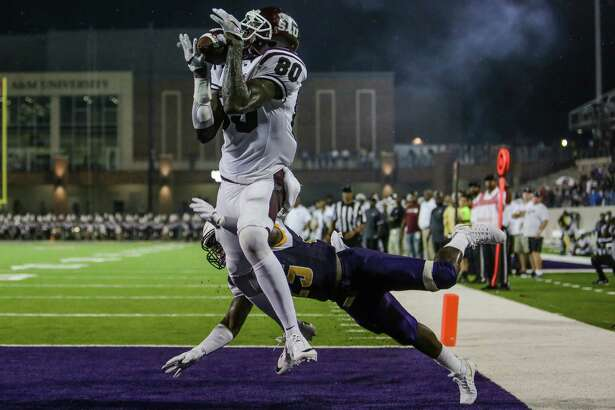 Texas Southern Tigers wide receiver Derrick Griffin (80) makes a catch, that was eventually called back, in the end zone past Prairie View Am Panthers cornerback Terrence Singleton (25) as the Prairie View Am Panthers take on the Texas Southern Tigers at Panther Stadium at Blackshear Field Sunday, September 4, 2016 in Prairie View. ( Michael Ciaglo / Houston Chronicle )
