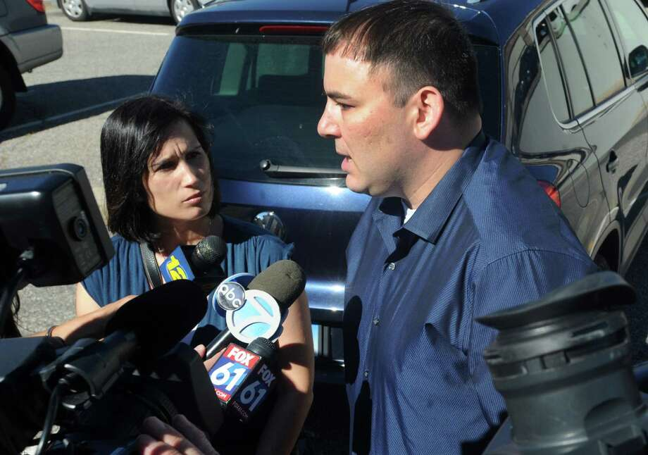 Michelle and Matthew Seagull, of Shelton, talk to the media after a court appearence by Carol Cardillo in Bridgeport, Conn. on Thursday, Sept. 15, 2016. The Seagull's infant son, Adam, died while in the care of Cardillo, owner of an unlicensed home daycare in Fairfield. Cardillo is charged with second-degree manslaughter, second-degree reckless endangerment and risk of injury to a minor. Photo: Cathy Zuraw / Hearst Connecticut Media / Connecticut Post