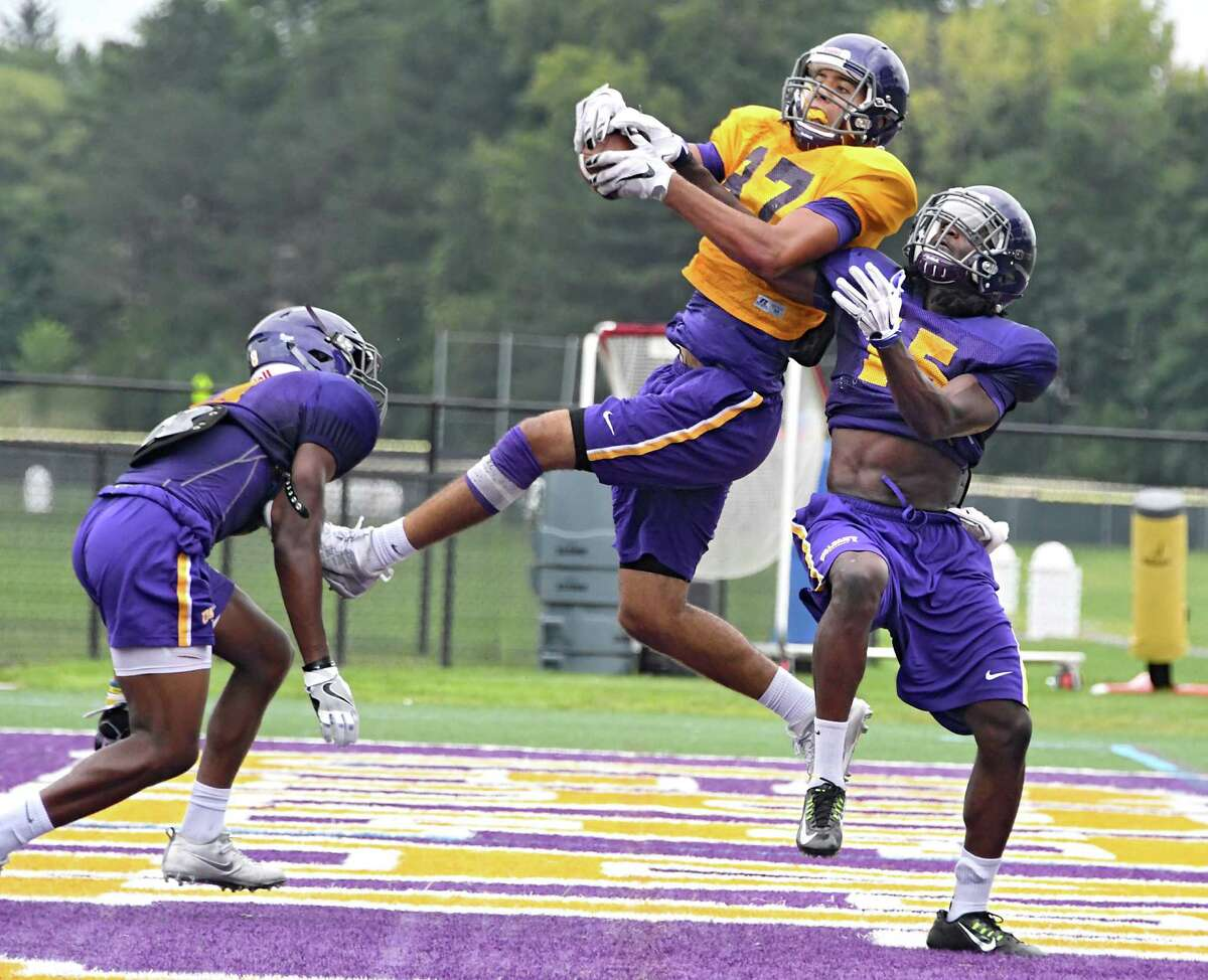 Cornerback Rayshan Clark, right, defends wide receiver Eugene Reyes during football practice at University at Albany on Wednesday, Aug. 31, 2016 in Albany, N.Y. Safety Mason Gray is seen at left. (Lori Van Buren / Times Union)