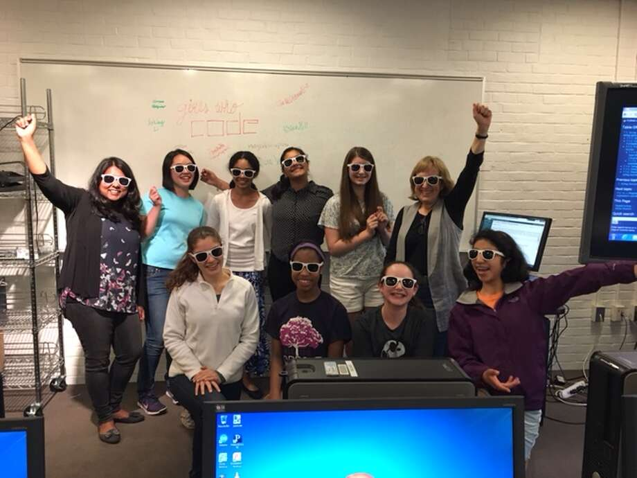 The Girls Who Code Club celebrates their last day of coding classes with their instructors. Photo: Contributed Photo
