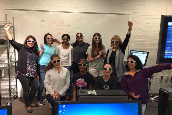 The Girls Who Code Club celebrates their last day of coding classes with their instructors.