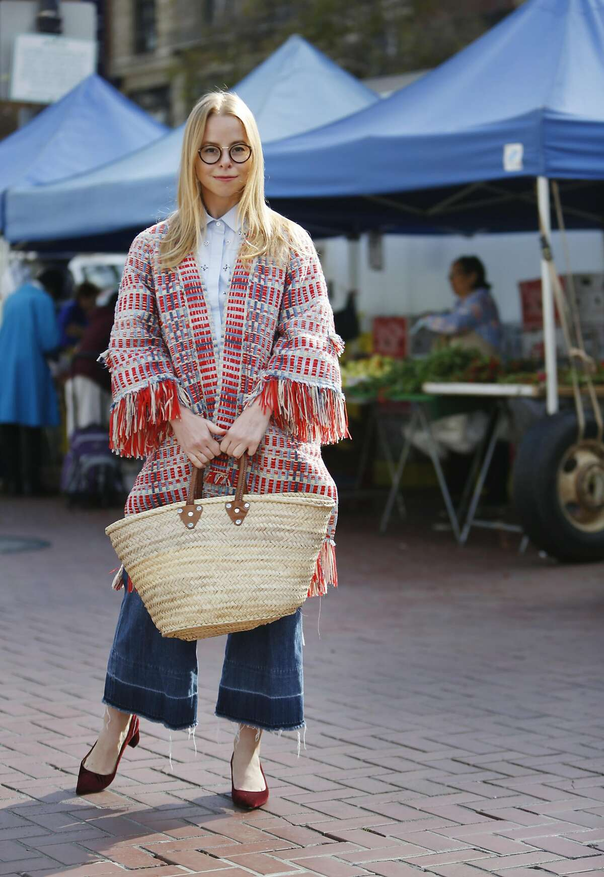 Fashion illustrator Gretchen Roehrs, stands for a portrait at the Heart of the City Farmers' Market at United Nations Plaza Wednesday, September 14, 2016 in San Francisco, California.