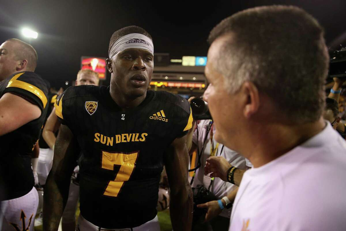 Running back Kalen Ballage of the Arizona State Sun Devils is congratulated by head coach Todd Graham after defeating Texas Tech Red Raiders 68-55 at Sun Devil Stadium on Sept. 10, 2015 in Tempe, Ariz.