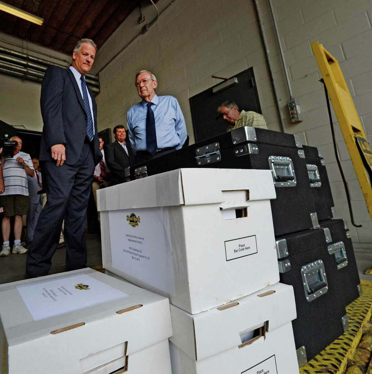 Capital OTB's John Signor, left and Rensselaer Mayor Dan Dwyer, right watch as the Rensselaer casino bid documents are delivered at the New York State Gaming building Monday morning June 30, 2014 in Schenectady, N.Y. (Skip Dickstein / Times Union archive)