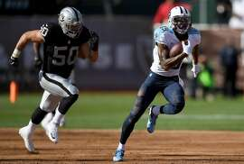 OAKLAND, CA - AUGUST 27:  Wide receiver Tajae Sharpe #19 of the Tennessee Titans runs with the ball while pursued by outside linebacker Ben Heeney #50 of the Oakland Raiders in the first half of their preseason football game at the Oakland Colsieum on August 27, 2016 in Oakland, California.  (Photo by Thearon W. Henderson/Getty Images)
