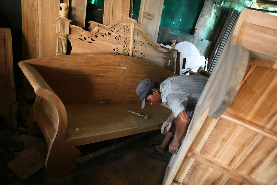A worker makes wooden furniture, which could be exported to the EU with a special license, in Medan. Photo: Binsar Bakkara, Associated Press