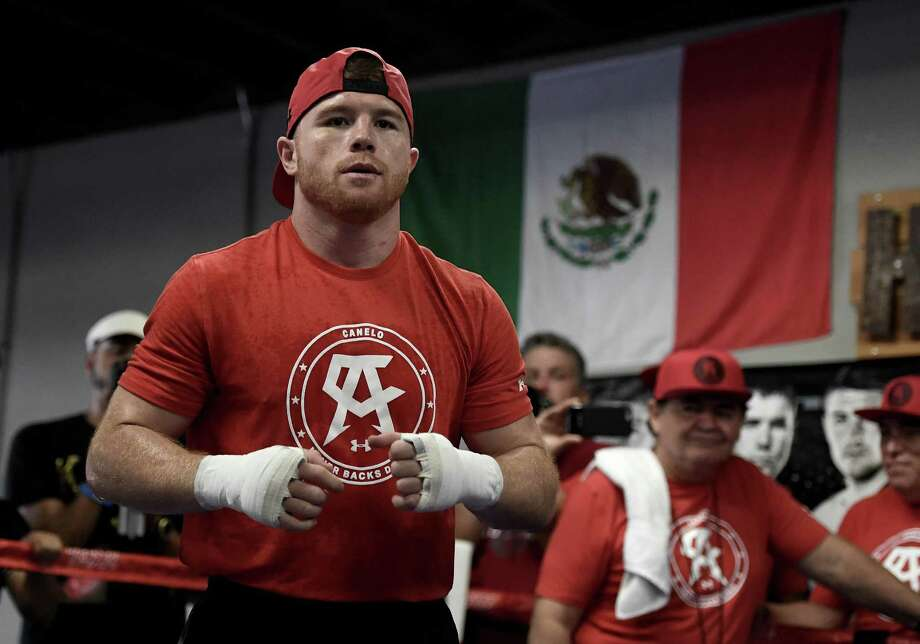 Boxer Canelo Alvarez of Mexico warms up in the ring during his open workout at the House of Boxing on Aug. 31, 2016 in San Diego. Alvarez fights Liam Smith of Great Britain for the WBO junior middleweight world championship on Sept. 17, 2016 in Arlington. Photo: Donald Miralle /Getty Images / Getty Images 2016