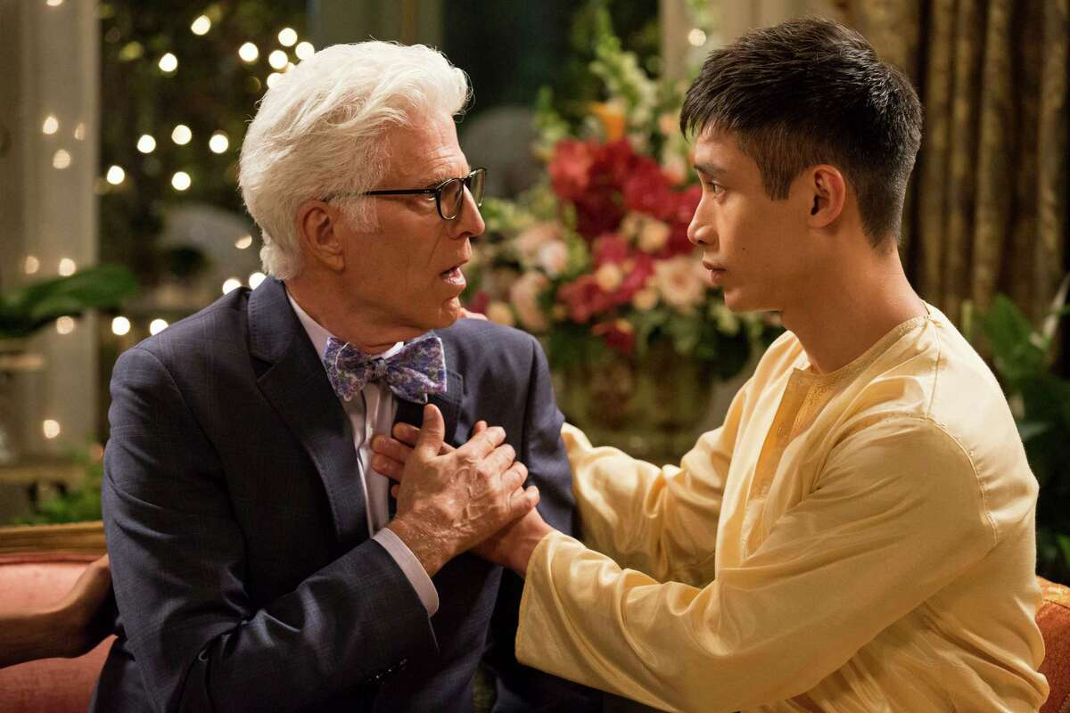 """THE GOOD PLACE -- """"Pilot"""" -- Pictured: (l-r) Ted Danson as Michael, Manny Jacinto as Jianyu -- (Photo by: Justin Lubin/NBC)"""
