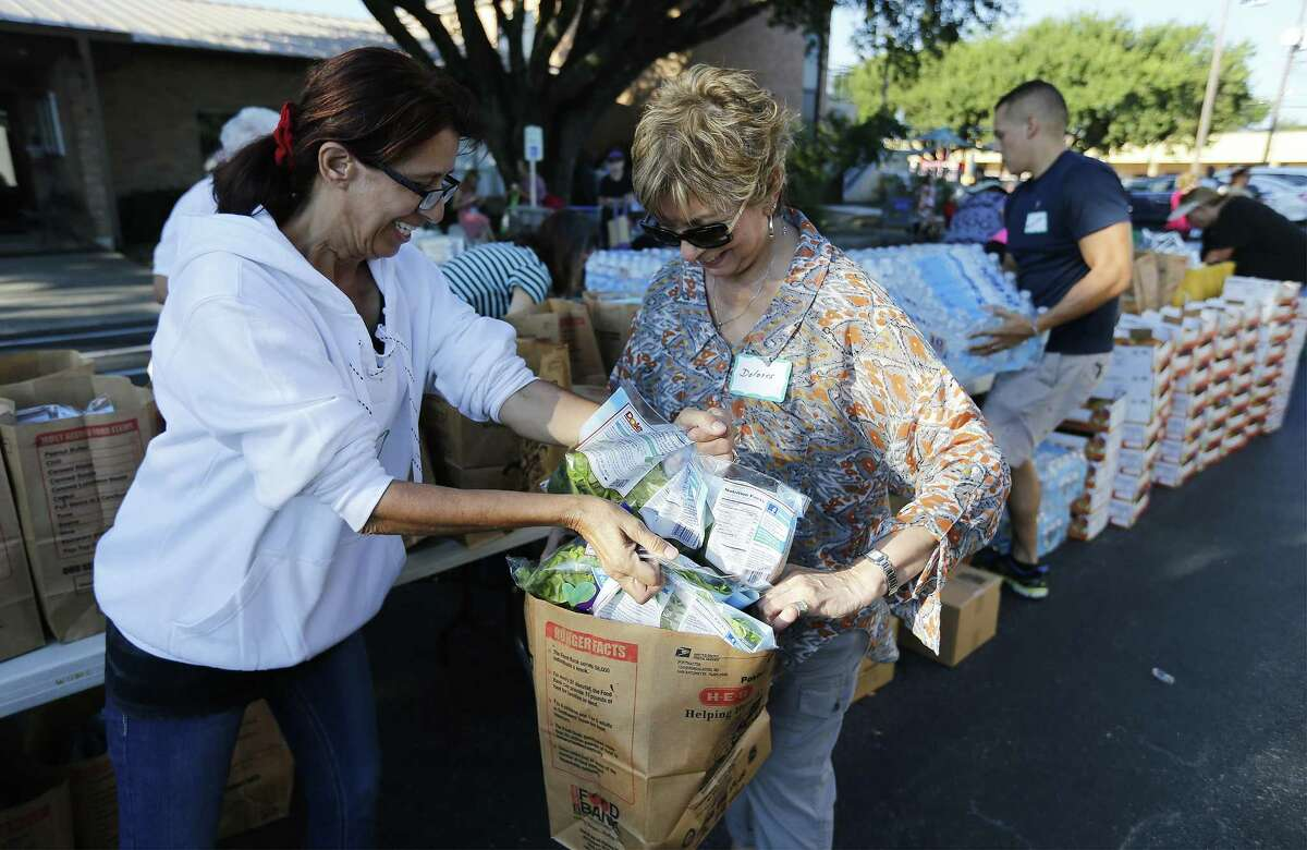 The needs are great for those living in poverty in Texas and many - such as these volunteers gathering food for the poor at Windcrest United Methodist Church on Sept. 15. But helping the needly will be hampered by a census undercount, cheating Texas of needed federal funds.