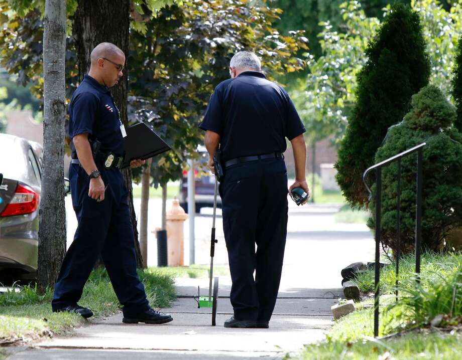 Columbus police search the scene where Tyree King,13, was killed. It's the latest in a string of officer-involved shootings that have fueled protests and national debate about policing tactics. Photo: PAUL VERNON, AFP/Getty Images