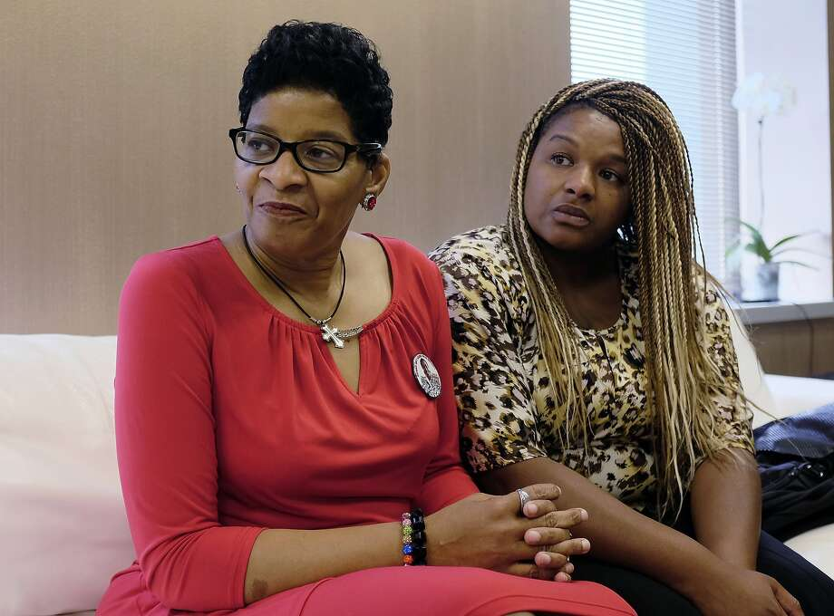 Geneva Reed-Veal, left, mother of Sandra Bland, a black Chicago-area woman who died in a Texas jail after a contentious traffic stop last summer, waits with her daughter Shavon Bland in the family's attorney's office, Thursday, Sept. 15, 2016, in Chicago. Bland died in her cell at the Waller County Jail three days after she was arrested by a white Texas state trooper for a minor traffic offense in July 2015. Her death was ruled a suicide, and Bland's family later sued the county and the Texas Department of Public Safety. (AP Phoro/Kiichiro Sato) Photo: Kiichiro Sato, Associated Press