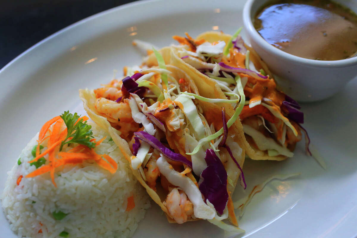 A slightly spicy chipotle cream sauce elevates these nicely-done shrimp tacos.