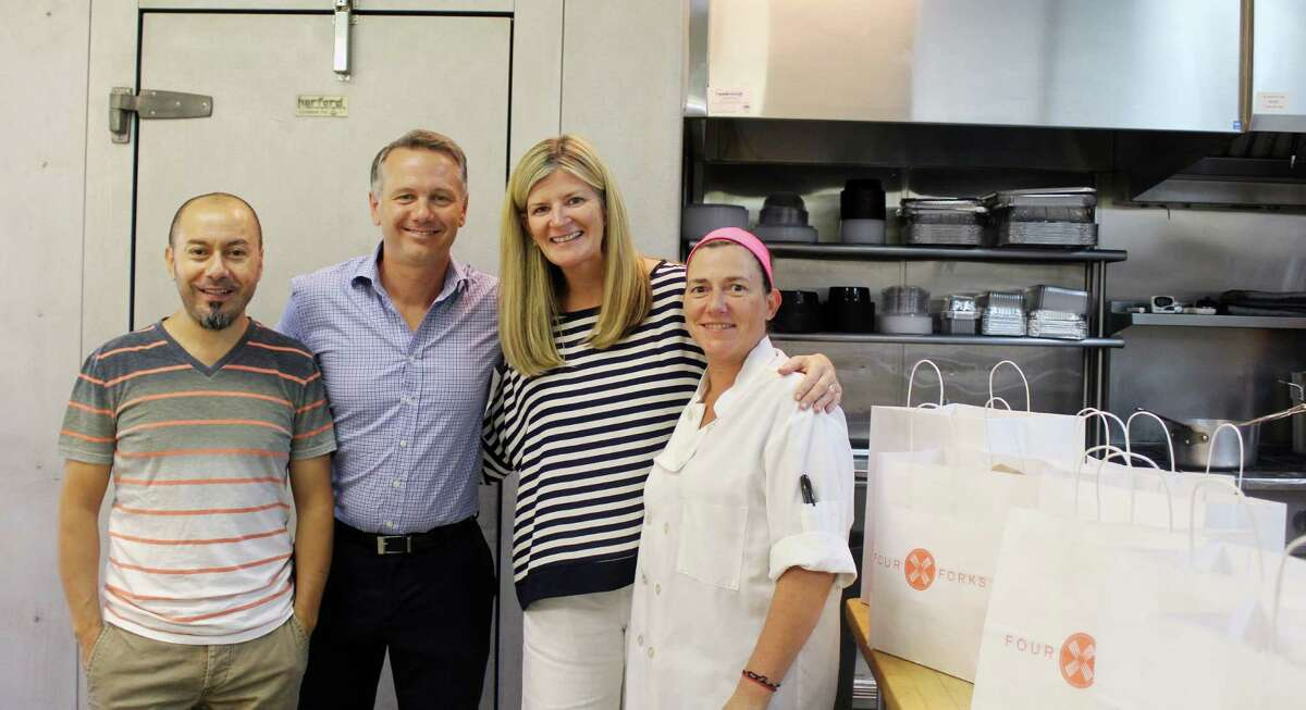 Four Forks employees Ernesto Escobar (left),Chris Ruppenstein, Megan Ruppenstein and Adriana Chicimeb in the kitchen of Four Forks in Darien, CT on Sept. 13, 2016.