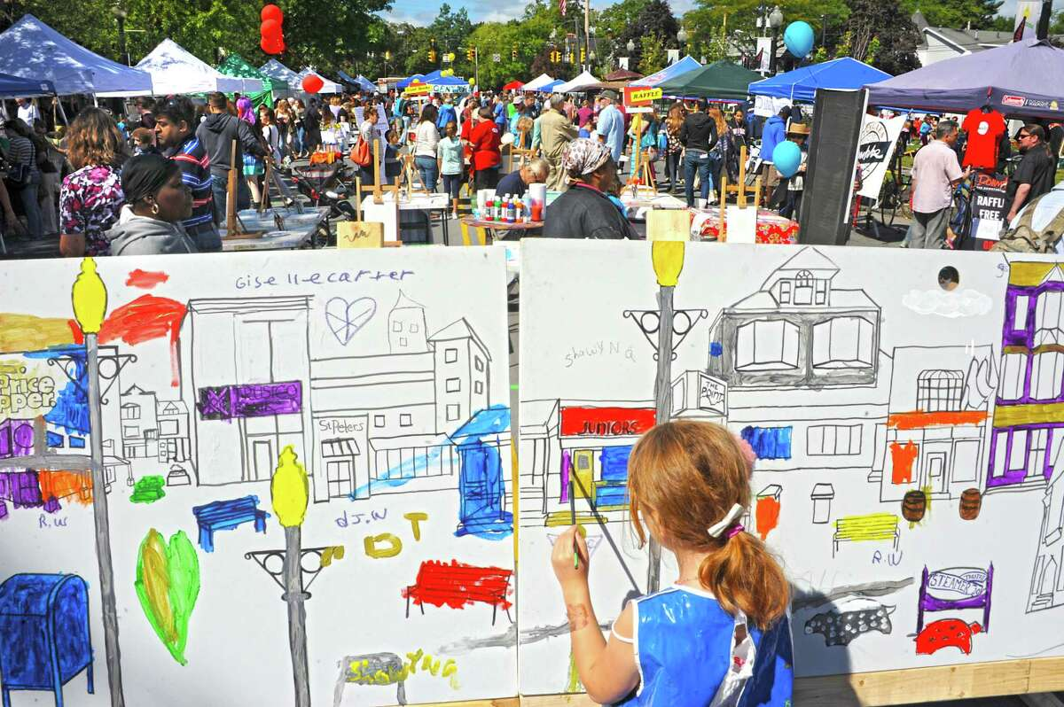 Sienna Stewart, 7, of Albany paints the exterior of Juniors on a mural during the The Upper Madison Street Fair on Sunday, Sept. 20, 2015 in Albany, N.Y. (Lori Van Buren / Times Union)