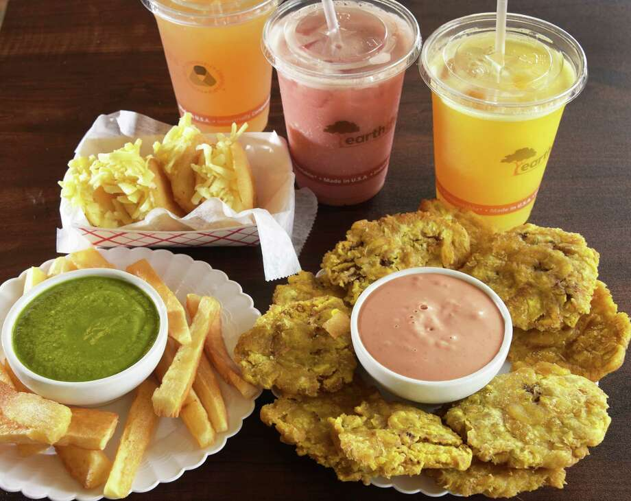 Appetizers, Arepias Fritas, Yuca Frita with cilantro dip and Tostones with pink sauce and signature juices at Oh Corn Arepas on Route 9, Saturday Sept. 10, 2016 in Halfmoon, NY.  (John Carl D'Annibale / Times Union) Photo: John Carl D'Annibale / 20037974A
