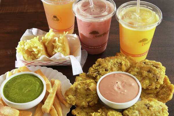 Appetizers, Arepias Fritas, Yuca Frita with cilantro dip and Tostones with pink sauce and signature juices at Oh Corn Arepas on Route 9, Saturday Sept. 10, 2016 in Halfmoon, NY.  (John Carl D'Annibale / Times Union)